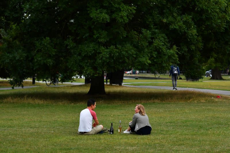 Friends enjoy a picnic on Clapham Common in London