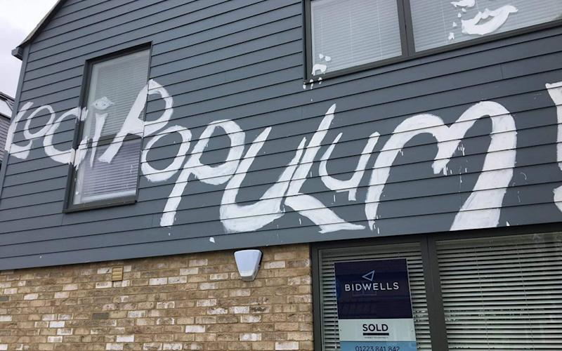 The phrases 'Loci Populum!' and 'Locus in Domos' - described as pidgin Latin, meaning 'a place for homes equals places for people' - were painted across new houses in Chesterton which cost more than £1.2million each - PA