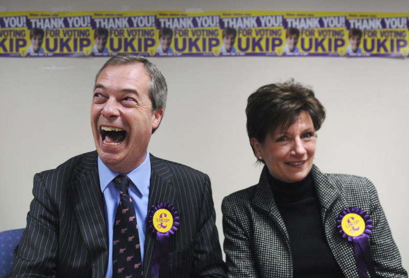 United Kingdom Independence Party, or UKIP leader Nigel Farage sits with his party's candidate for the Eastleigh by-election Diane James  as they attend a news conference a news conference in  Eastleigh England Friday March 1, 2013.  The right-wing euroskeptic UKIP party committed to pulling the United Kingdom out of the European Union handed an embarrassing midterm electoral defeat to David Cameron's Conservatives on Friday, beating the ruling Tories to second place in a special election in the southern England town of Eastleigh. (AP Photo/ Stefan Rousseau/PA)  UNITED KINGDOM OUT  The re