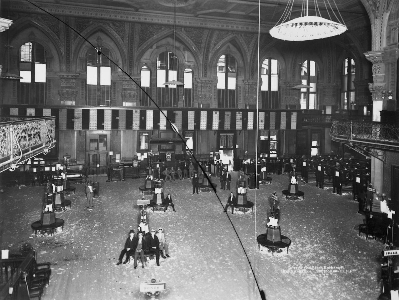 Interior of the New York Stock Exchange, old building: brokers sitting around, New York, 1895.