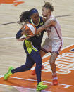 Connecticut Sun guard Natisha Hiedeman commits the foul on Dallas Wings guard Arike Ogunbowale during a WNBA basketball game Tuesday, June 22, 2021, at Mohegan Sun Arena in Uncasville, Conn. (Sean D. Elliot/The Day via AP)