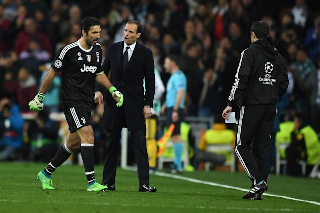 Juventus manager Max Allegri consoles Gianluigi Buffon after his sending off. (Getty)