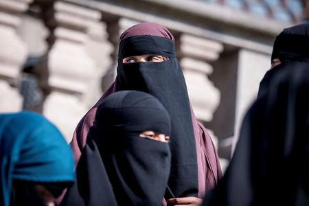 Women in niqab exit the audience seats after the Danish Parliament banned the wearing of face veils in public, at Christiansborg Palace in Copenhagen, Denmark, May 31, 2018. Ritzau Scanpix/Mads Claus Rasmussen/via REUTERS