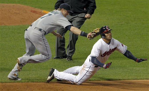 Cleveland Indians' Johnny Damon is caught on a run down and tagged out by Seattle Mariners first baseman Justin Smoak in the fourth inning of a baseball game in Cleveland on Wednesday, May 16, 2012. (AP Photo/Amy Sancetta)