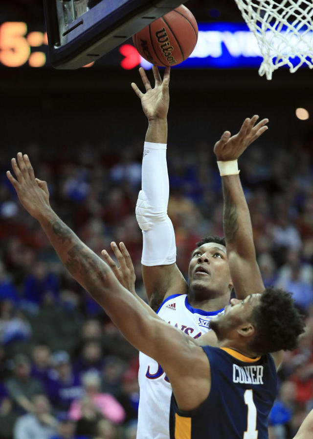 Kansas forward David McCormack (33) shoots over West Virginia forward Derek Culver (1) during the first half of an NCAA college basketball game in the semifinals of the Big 12 conference tournament in Kansas City, Mo., Friday, March 15, 2019. (AP Photo/Orlin Wagner)