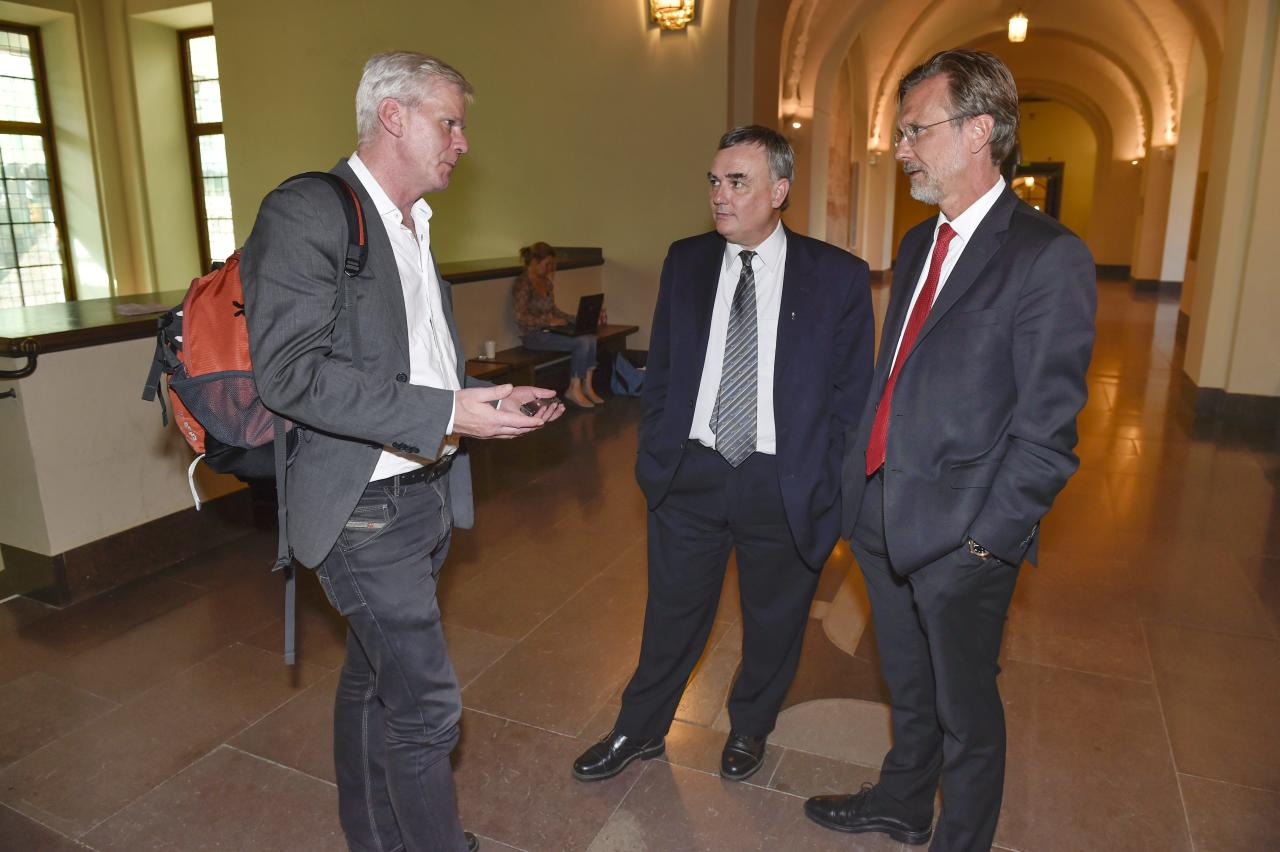 "WikiLeak's spokesperson Kristinn Hrafnsson, left, talks to Julian Assange's lawyers Per E Samuelsson and Tomas Olsson, right, after a public court hearing in Stockholm on Wednesday July 16, 2014. A Swedish court on Wednesday upheld its detention order on Julian Assange, reaffirming the legal basis for an international warrant for the WikiLeaks founder which has kept him hiding in the Ecuadorean Embassy in London for two years. One of Assange's defense lawyers, Per Samuelson, said they would study the judge's decision in detail and then ""write a juicy, toxic appeal"" to a higher court. (AP Photo/TT, Roger Vikstrom) SWEDEN OUT"