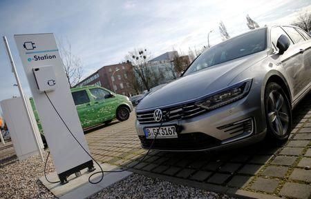 An electric Volkswagen Passat car is pictured at charging station at a VW dealer in Berlin, Germany, February 2, 2016.  REUTERS/Fabrizio Bensch