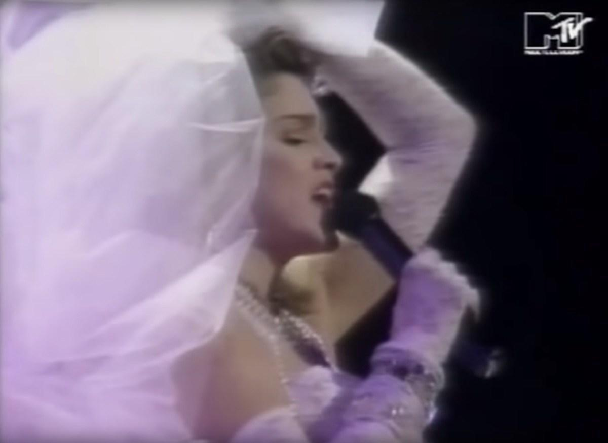 """While 26-year-old <strong>Madonna</strong> actually wanted to sing to a live white Bengal tiger <a href=""""https://bestlifeonline.com/mtv-vma-facts/?utm_source=yahoo-news&utm_medium=feed&utm_campaign=yahoo-feed"""">at the very first VMAs</a> in 1984, her <a href=""""https://www.youtube.com/watch?v=gkSxhG4cbPo"""" target=""""_blank"""">emergence from a 17-foot wedding cake</a> in that iconic lace bustier and wedding veil was just as epic. Not to mention, that writhing around on the floor, all because of a missing high heel.  """"I walked down these steps which were the tiers of a wedding cake, and I lost…my white stiletto,"""" <a href=""""https://www.yahoo.com/entertainment/blogs/stop-the-presses/madonna-1984-vmas-wedding-dress-wed-her-pop-073524862.html?_ga=2.245560899.65199635.1565477835-629911203.1565477835"""" target=""""_blank"""">she told<strong>Jay Leno</strong></a> in 2012. """"I thought, 'Oh my God, how am I going to get that? It's over there and I'm on TV.' So I thought, 'Well, I'll pretend I meant to do this,' and I dove onto the floor."""" And the rest, as they say, is history."""