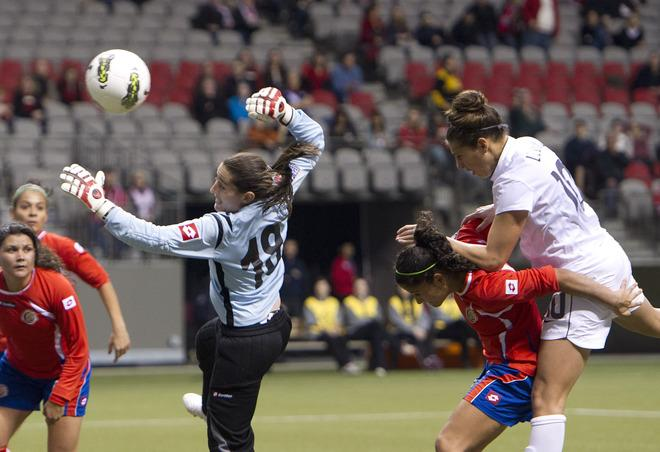 VANCOUVER, CANADA - JANUARY 27:  Carli Lloyd #10 of the United States heads the ball wide of the net and goalie Erika Miranda #18 of Costa Rica after out battling Carol Sanchez #6 of Costa Rica during the first half of semifinals action of the 2012 CONCACAF Women's Olympic Qualifying Tournament at BC Place on January 27, 2012 in Vancouver, British Columbia, Canada.  (Photo by Rich Lam/Getty Images)