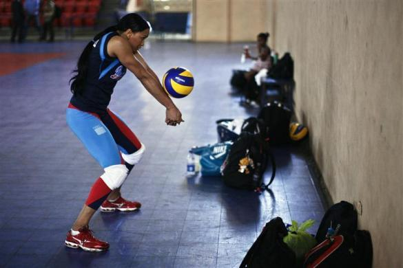 Milagros Cabral, captain of the Dominican Republic volleyball team practices during training season at the Olympic center in Santo Domingo in this picture taken May 22, 2012. The team qualified for one of the only three spots for women's volleyball teams from the Americas to play at the London Olympics, along with the United States and Brazil.
