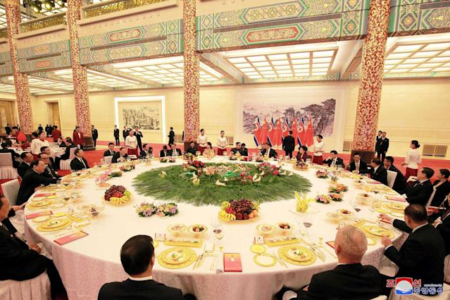 <p>North Korean leader Kim Jong Un and wife Ri Sol Ju, and Chinese President Xi Jinping and wife Peng Liyuan attend a banquet in Beijing, China, in this undated photo released by North Korea's Korean Central News Agency (KCNA) in Pyongyang, March 28, 2018. (Photo: KCNA/via Reuters) </p>