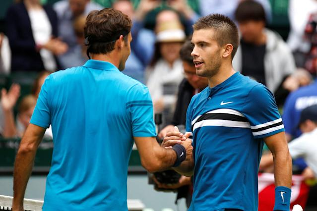 Tennis - ATP - Halle Open Finals - Gerry Weber Stadion, Halle, Germany - June 24, 2018 Croatia's Borna Coric shakes hands with Switzerland's runner up Roger Federer after winning the final REUTERS/Leon Kuegeler