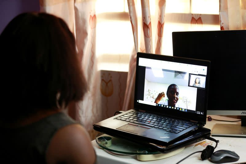 Loveth Metiboba, a researcher and a mother of one is seen during teleconsultation with Dr. Marieta Ekeng of EHA clinics in Abuja