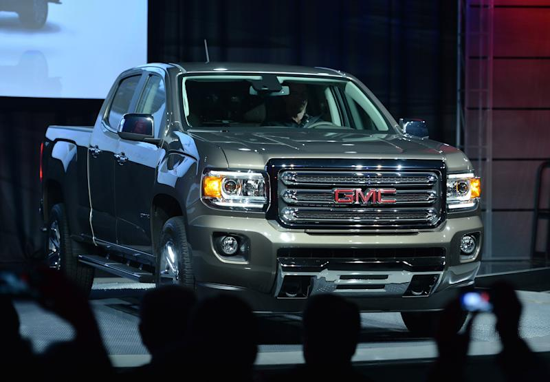 The new GMC Canyon midsize pickup is presented at Russell Industrial Center in advance of the North American International Auto Show January 12, 2014 in Detroit, Michigan. Press previews begin January 13. AFP PHOTO/Stan HONDA (Photo credit should read STAN HONDA/AFP via Getty Images)