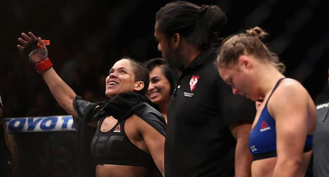 Amanda Nunes (L) of Brazil reacts after defeating Ronda Rousey in their UFC women's bantamweight championship bout during the UFC 207 event at T-Mobile Arena on December 30, 2016 in Las Vegas, Nevada. (Getty Images)