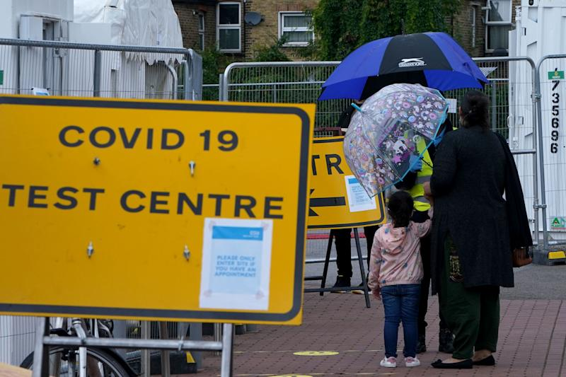 LONDON, ENGLAND - SEPTEMBER 23: People queue outside a COVID-19 testing centre in Walthamstow on September 23, 2020 in London, England. Cases have risen to 5000 per day, and are at their highest since the height of lockdown in May. (Photo by Mark Case/Getty Images)