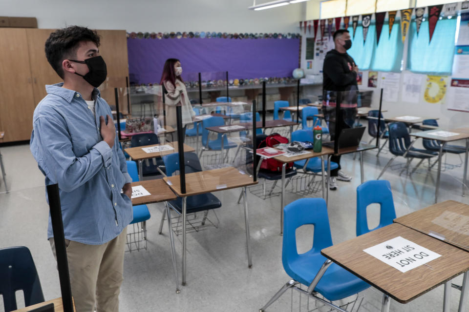 Sierra Vista High students recite the Pledge of Allegiance as they return to in-class instruction for the first time in more than a year. (Robert Gauthier/Los Angeles Times via Getty Images)