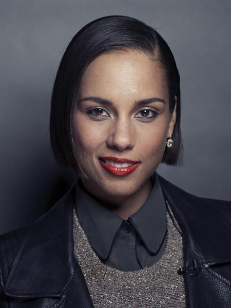 "In this Monday, Nov. 26, 2012 photo, American singer-songwriter, record producer and actress, Alicia Keys poses for a portrait in promotion of her fifth album ""Girl on Fire,"" in New York. The album releases this week, and features Frank Ocean, Bruno Mars, Babyface, Emeli Sande, Maxwell, Nicki Minaj, John Legend, her husband Swizz Beatz and their son Egypt. (Photo by Victoria Will/Invision/AP)"
