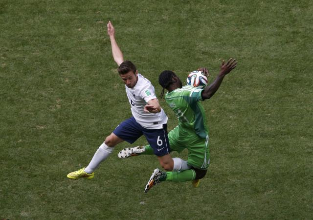 France's Yohan Cabaye (L) fights for the ball with Nigeria's Victor Moses during their 2014 World Cup round of 16 game at the Brasilia national stadium in Brasilia June 30, 2014. REUTERS/David Gray (BRAZIL - Tags: SOCCER SPORT WORLD CUP)