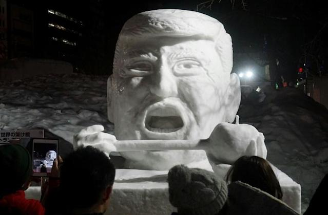 An ice sculpture of US President Donald Trump featured during the 2017 Sapporo Snow Festival, but this year organisers are having to truck-in powder from outlying areas (AFP Photo/TOSHIFUMI KITAMURA)