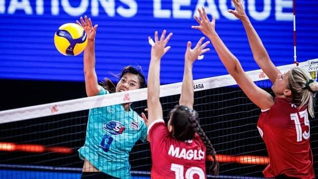 Emily Maglio, left, Brie King, right, and their Canadian teammates lost their fourth consecutive volleyball match and second in a row by sweep, falling 25-16, 25-17, 25-17 to Thailand on Saturday in Rimini, Italy. (Submitted by Volleyball World - image credit)