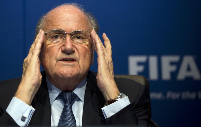 """FILE - In this March 30, 2012 file picture FIFA President Sepp Blatter gestures during a press conference at the FIFA headquarters in Zurich, Switzerland. Soccer is falling under a cloud of suspicion as never before, sullied by a multibillion-dollar web of match-fixing that is staining increasingly larger parts of the world's most popular sport. FIFA President Sepp Blatter has proclaimed """"zero tolerance"""" for match-fixing, and FIFA has pledged $27 million to Interpol to fight it. (AP Photo/Anja Niedringhaus,File)"""