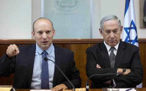 Naftali Bennett (left) said he would not walk out of the coalition - Credit: ABIR SULTAN/AFP/Getty Images