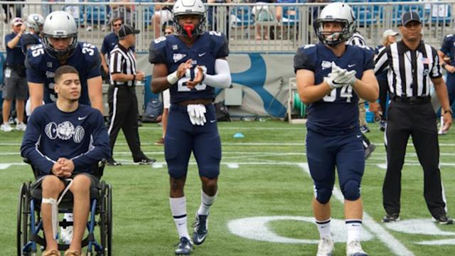 "Georgetown senior <a class=""link rapid-noclick-resp"" href=""/ncaaf/players/288348/"" data-ylk=""slk:Ty Williams"">Ty Williams</a> was paralyzed in a collision with an opponent while trying to knock down a pass during the 2015 season (AP Photo)."