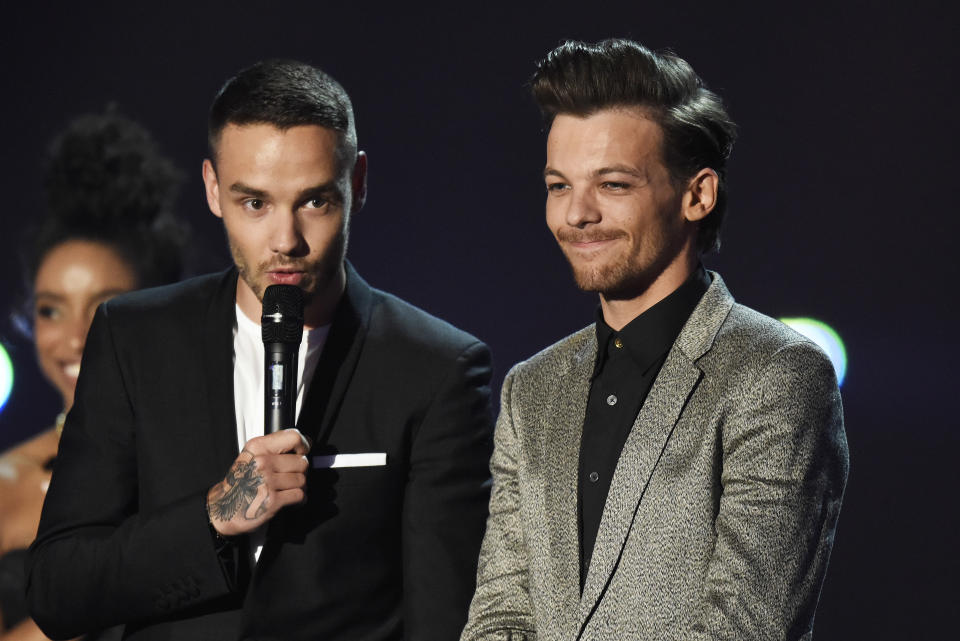 LONDON, ENGLAND - FEBRUARY 24: (EDITORIAL USE ONLY)  Liam Payne and Louis Tomlinson from One Direction accept the award for British Artist Video at the BRIT Awards 2016 at The O2 Arena on February 24, 2016 in London, England.  (Photo by Dave J Hogan/Dave J Hogan/Getty Images)