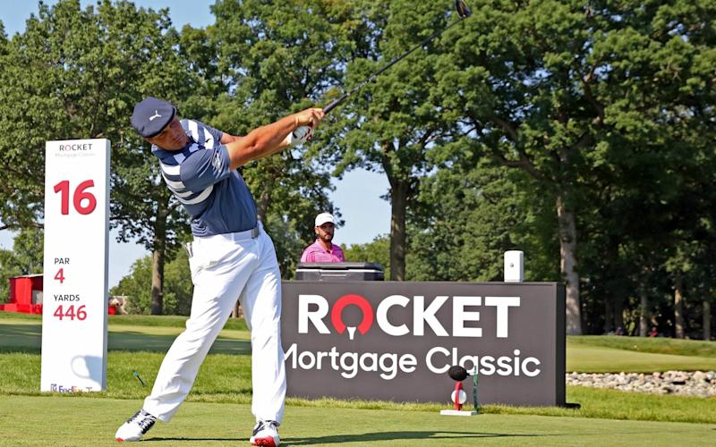 Bryson DeChambeau hits his tee shot on the 16th hole during the Rocket Mortgage Classic golf tournament - USA Today