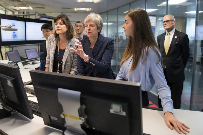 Britain's Prime Minister Theresa May during a visit to Imperial College where she saw machinery which converts carbon dioxide into oxygen in London Wednesday