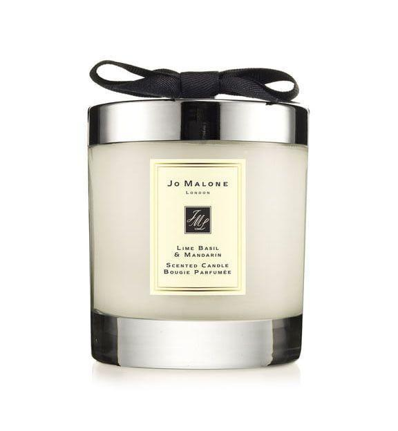 """<p><strong>JO MALONE LONDON</strong></p><p>nordstrom.com</p><p><strong>$69.00</strong></p><p><a href=""""https://go.redirectingat.com?id=74968X1596630&url=https%3A%2F%2Fwww.nordstrom.com%2Fs%2Fjo-malone-london-lime-basil-mandarin-scented-home-candle%2F3010757&sref=https%3A%2F%2Fwww.goodhousekeeping.com%2Flife%2Fentertainment%2Fg34862781%2Fbest-scented-candles%2F"""" rel=""""nofollow noopener"""" target=""""_blank"""" data-ylk=""""slk:Shop Now"""" class=""""link rapid-noclick-resp"""">Shop Now</a></p><p>Meghan Markle and Kate Middleton are both fans of Jo Malone, so you know it's worth every penny. The notes of limes, mandarins, basil, and white thyme are the perfect for adding a fresh scent to your home. </p>"""