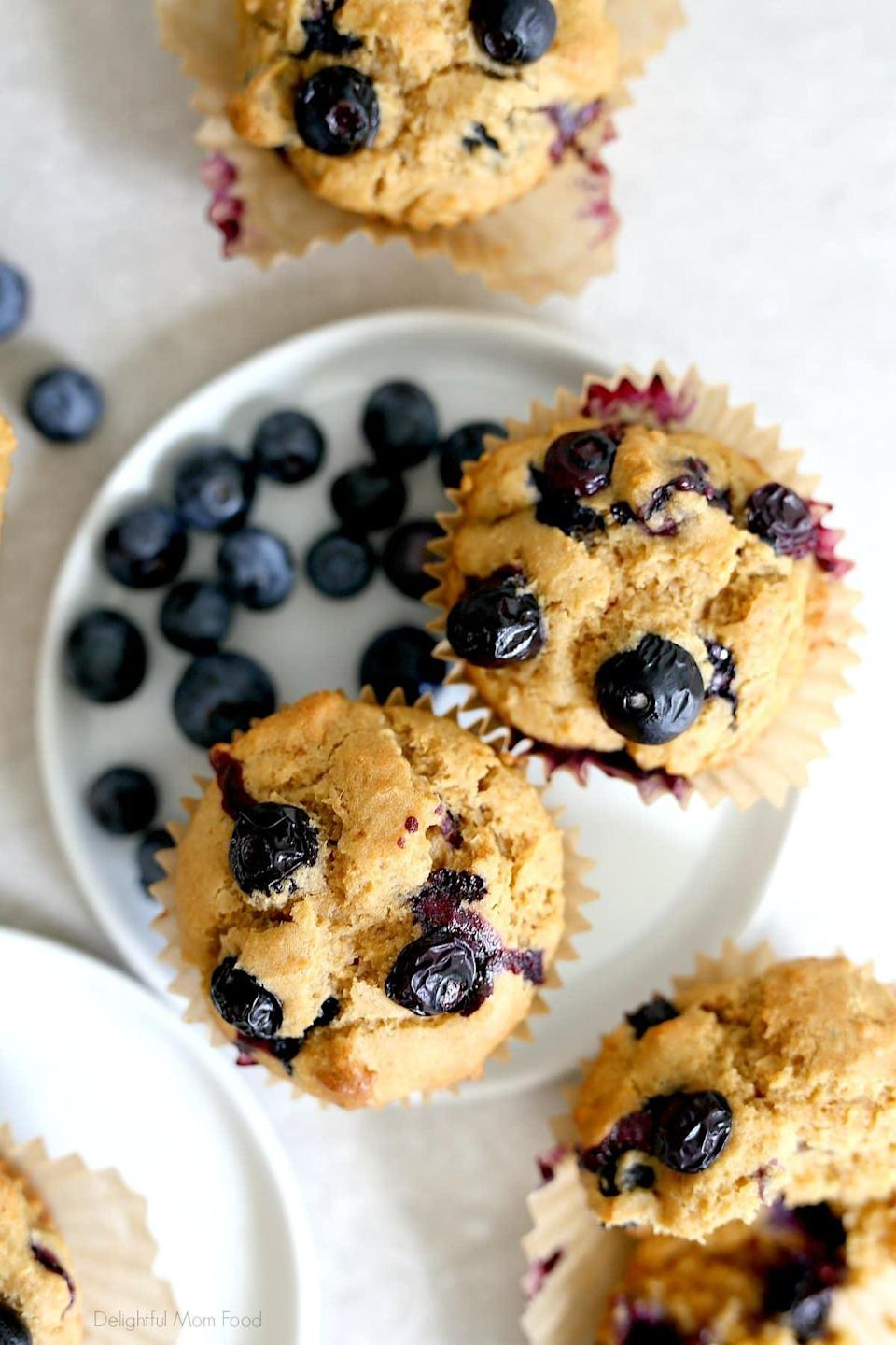 """<p>Your kids will probably ask for seconds after they try Delightful Mom Food's <a href=""""https://delightfulmomfood.com/blueberry-muffins/"""" class=""""link rapid-noclick-resp"""" rel=""""nofollow noopener"""" target=""""_blank"""" data-ylk=""""slk:gluten-free blueberry muffins"""">gluten-free blueberry muffins</a>. Fresh blueberries add a burst of flavor, applesauce makes them moist, and they're easy enough to whip up that the kids can help prep their own breakfast!</p>"""