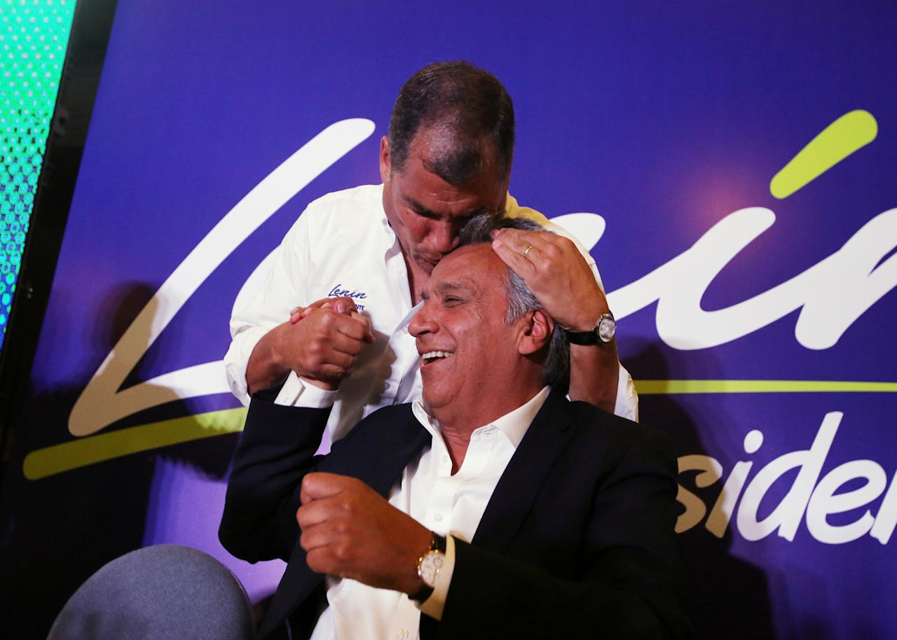 Ecuador's President Rafael Correa (top) kisses Lenin Moreno, candidate of the ruling PAIS Alliance Party, at the Hotel Colon during the presidential election in Quito, Ecuador February 19, 2017. REUTERS/Mariana Bazo