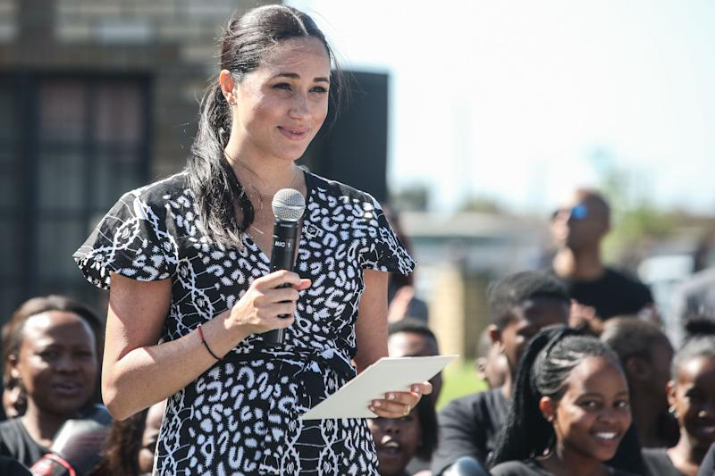 "Meghan, Duchess of Sussex gives a speech during a visit to the ""Justice desk"", an NGO in the township of Nyanga in Cape Town, as they begin their tour of the region on September 23, 2019. - Britain's Prince Harry and his wife Meghan arrived in South Africa on September 23, launching their first official family visit in the coastal city of Cape Town. The 10-day trip began with an education workshop in Nyanga, a township crippled by gang violence and crime that sits on the outskirts of the city. (Photo by Betram MALGAS / various sources / AFP) (Photo credit should read BETRAM MALGAS/AFP via Getty Images)"