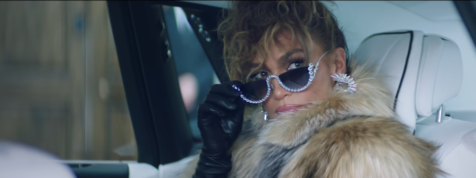 <p>Sitting in a car, she lowers her bejeweled sunglasses with a leather-gloved hand. Her blazer is from Tibi, the fur coat from La Pointe, and the bling from Yeprem.</p>