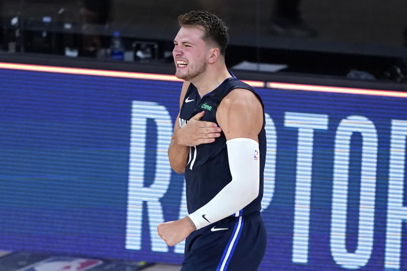 Dallas Mavericks' Luka Doncic celebrates after making a winning 3-point basket against the Los Angeles Clippers during overtime of an NBA basketball first round playoff game Sunday, Aug. 23, 2020, in Lake Buena Vista, Fla. The Mavericks won 135-133 in overtime. (AP Photo/Ashley Landis, Pool)
