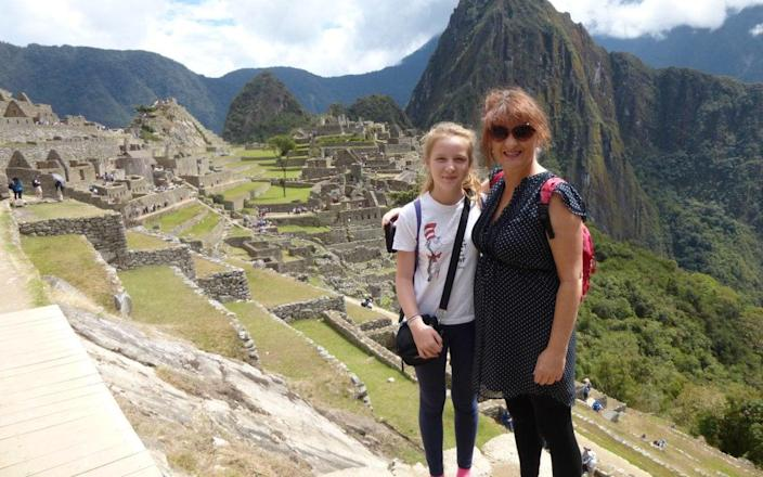 Judith and her daughter at Machu Picchu in Peru, where a pisco turned her holiday sour