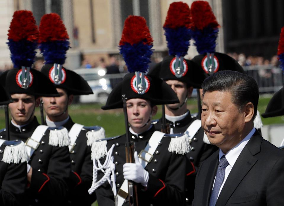 """Chinese President Xi Jinping pays his tribute to the Monument of the Unknown Soldier, in Rome, Friday, March 22, 2019. Jinping is launching a two-day official visit aimed at deepening economic and cultural ties with Italy through an ambitious infrastructure building program called """"Belt and Road"""" that has raised suspicions among Italy's U.S. and European allies. (AP Photo/Alessandra Tarantino)"""