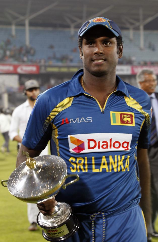 Sri Lanka's captain Angelo Mathews holds the winning trophy after Sri Lanka won the 2014 Asia Cup final against Pakistan in Dhaka March 8, 2014. REUTERS/Andrew Biraj (BANGLADESH - Tags: SPORT CRICKET)
