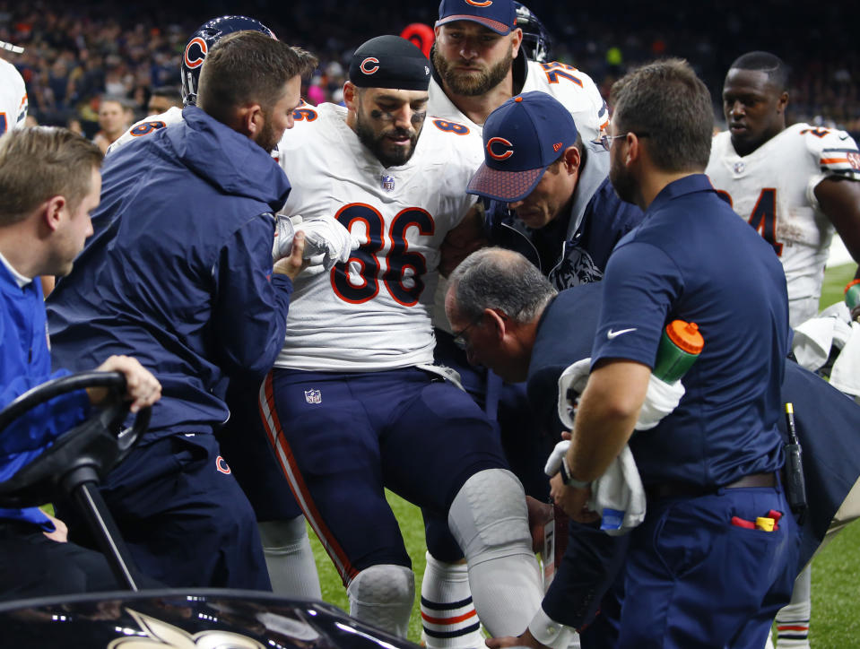 Chicago Bears tight end Zach Miller is placed on a cart after injuring his leg in the second half of Sunday's game against the New Orleans Saints. (AP)