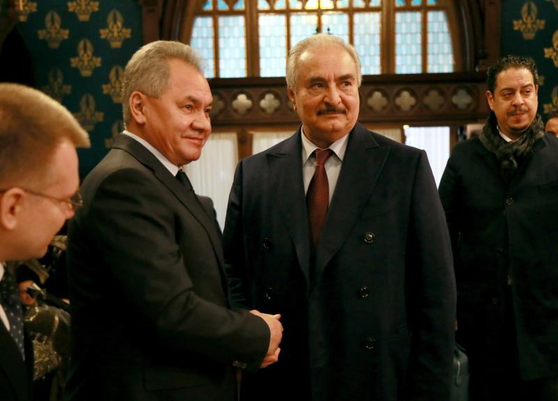 Commander of the Libyan National Army (LNA) Khalifa Haftar (C) shaking hands with Russian Defense Minister Sergei Shoigu (2-L) during their meeting in Moscow, Russia, 13 January 2020 (issued 14 January 2020). EFE/EPA/MINISTRY OF FOREIGN AFFAIRS PRESS SERVICE HANDOUT