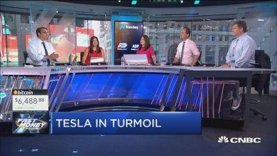 CEO Elon Musk gave an emotional interview to The New York Times, and investors rewarded him by selling the stock. Is game over for Tesla? With CNBC's Melissa Lee and the Fast Money traders, Brian Kelly, Gina Sanchez, David Seaburg and Dan Nathan.