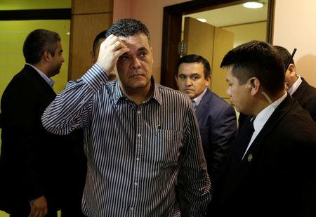 President of Paraguay's Congress Roberto Acevedo leaves his office in the Congress building in Asuncion
