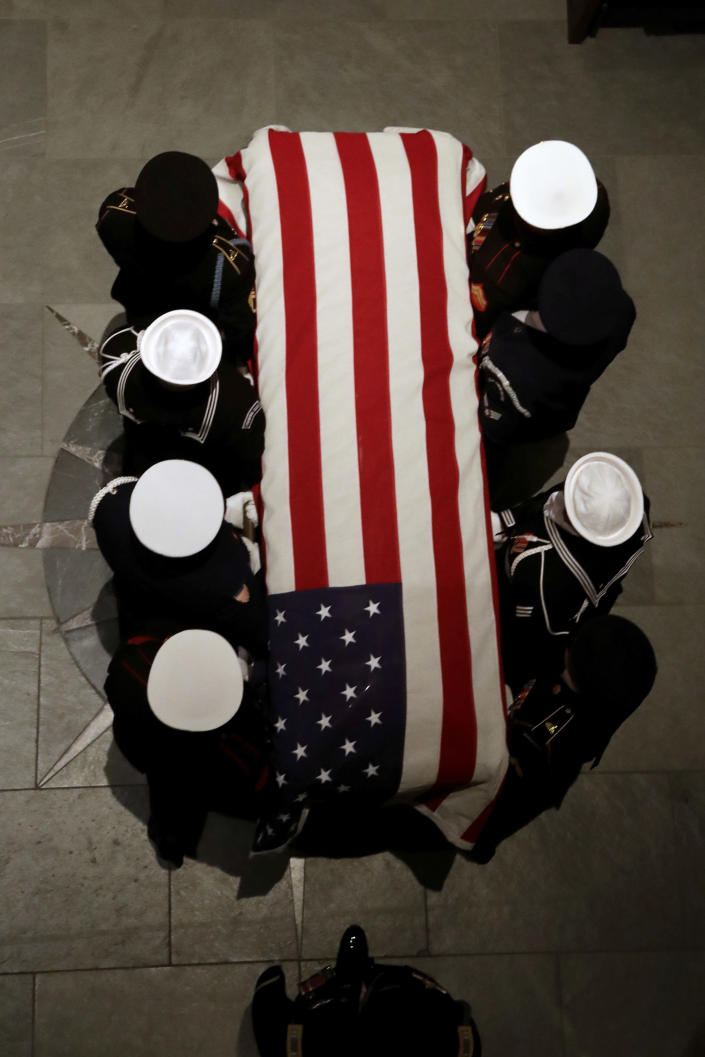 The flag-draped casket of former President George H.W. Bush is carried by a joint services military honor guard at St. Martin's Episcopal Church Wednesday, Dec. 5, 2018, in Houston. (Photo: Mark Humphrey/AP)