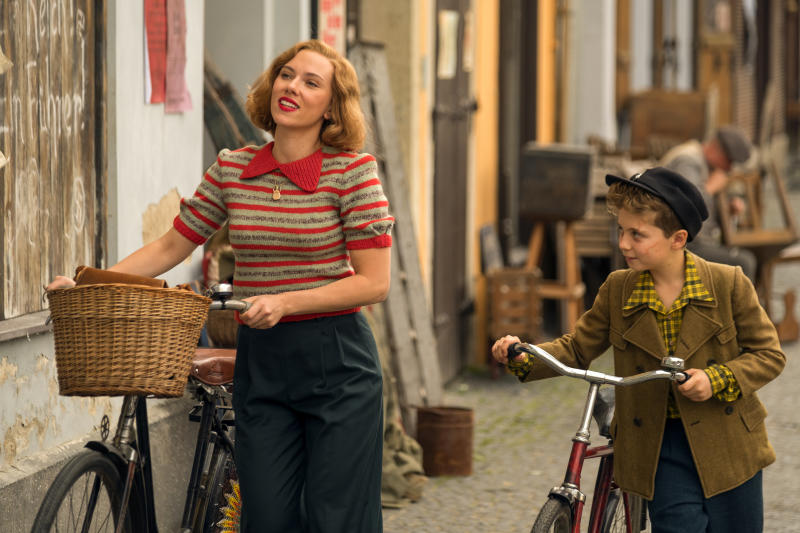 """This image released by Fox Searchlight Pictures shows Scarlett Johansson, left, and Roman Griffin Davis in a scene from the WWII satirical film """"Jojo Rabbit."""" (Larry Horricks/Fox Searchlight Pictures via AP)"""