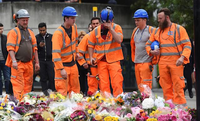 <p>A group of construction workers react as they leave flowers on the south side of London Bridge near Borough Market after an attack left 7 people dead and dozens of injured in London, Britain, June 5, 2017. (Photo: Clodagh Kilcoyne/Reuters) </p>