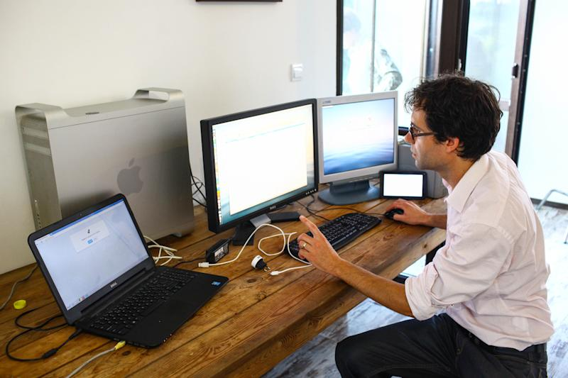 Stephane Lucon demonstrates on July 3, 2014 at his house in Croitori, the app for his start-up Hubert developped to help the elderly use the Internet and break their digital isolation (AFP Photo/Andrei Pungovschi)