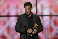 CORRECTS TO NFL DEFENSIVE ROOKIE, NOT DEFENSIVE PLAYER - John Bosa accepts the AP Defensive Rookie of the Year award for is son San Francisco 49ers' Nick Bosa at the NFL Honors football award show Saturday, Feb. 1, 2020, in Miami. (AP Photo/David J. Phillip)