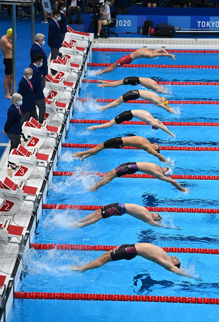<p>Swimmers compete in the final of the men's 4x100m medley relay swimming event during the Tokyo 2020 Olympic Games at the Tokyo Aquatics Centre in Tokyo on August 1, 2021. (Photo by Jonathan NACKSTRAND / AFP)</p>